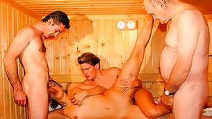 Group sex where a cute babe having several cocks in her holes