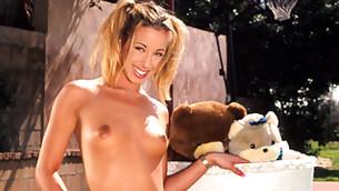 Slutty school girl is posing half naked on her parent's back yard