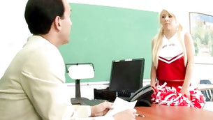 Charming and adorable school leader is sitting on the desk with undressed boobs and cum-hole