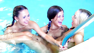Three prodigious twisted chicks are swimming in pool fully undraped