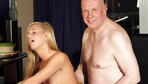 Bald fellow is fucking this golden haired skinny girl from behind deep
