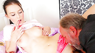She is licking the finger while fella is moisturizing her axil hole