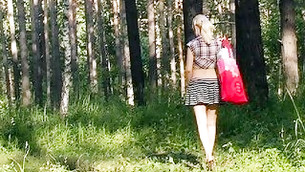 Tuneful innocent miss is walking in the woods looking seductive and hot