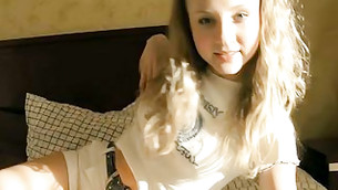 Teen long haired honey is looking extremely enchanting on her bed