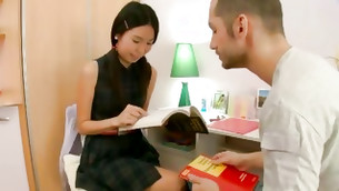 Incredibly sexy and beautiful Asian chick is reading something carefully